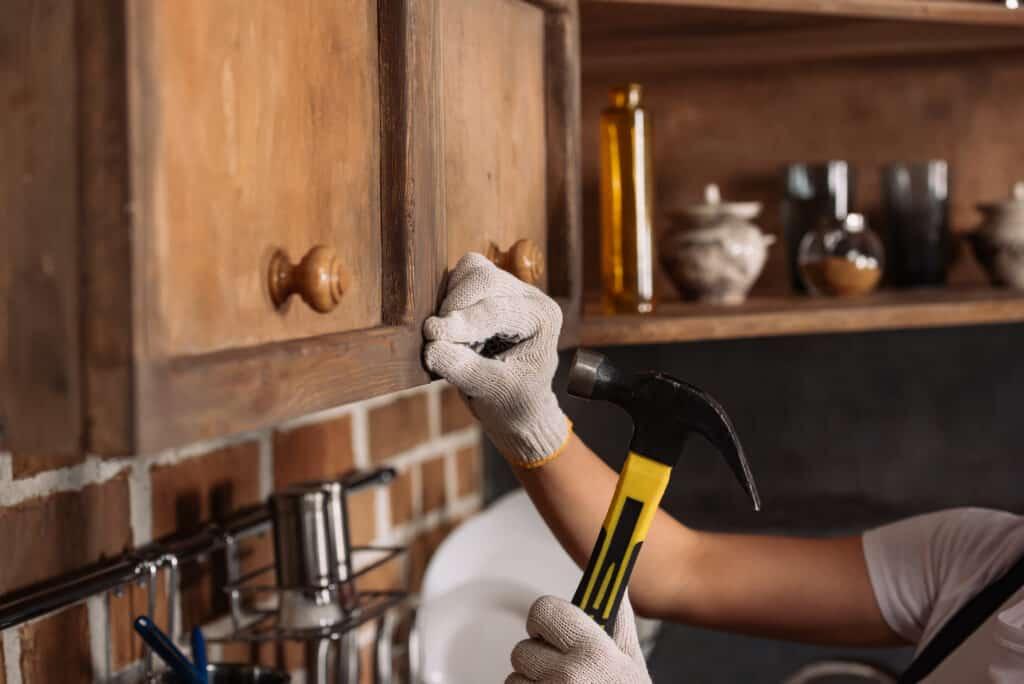 Cropped shot of repairwoman in work gloves