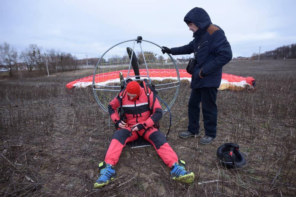 Paramotorist sitting on the ground