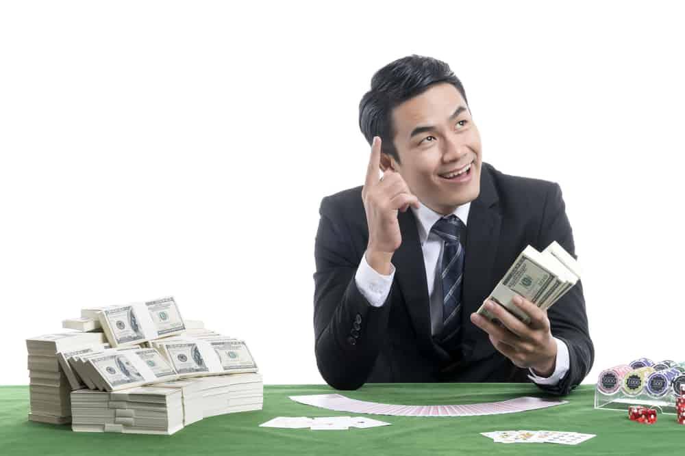 gambling casino owner man in black suit