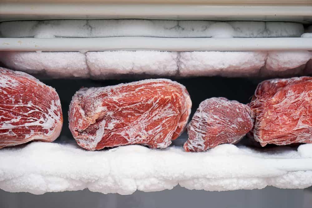 Big chunks of red beef lying on the freezer