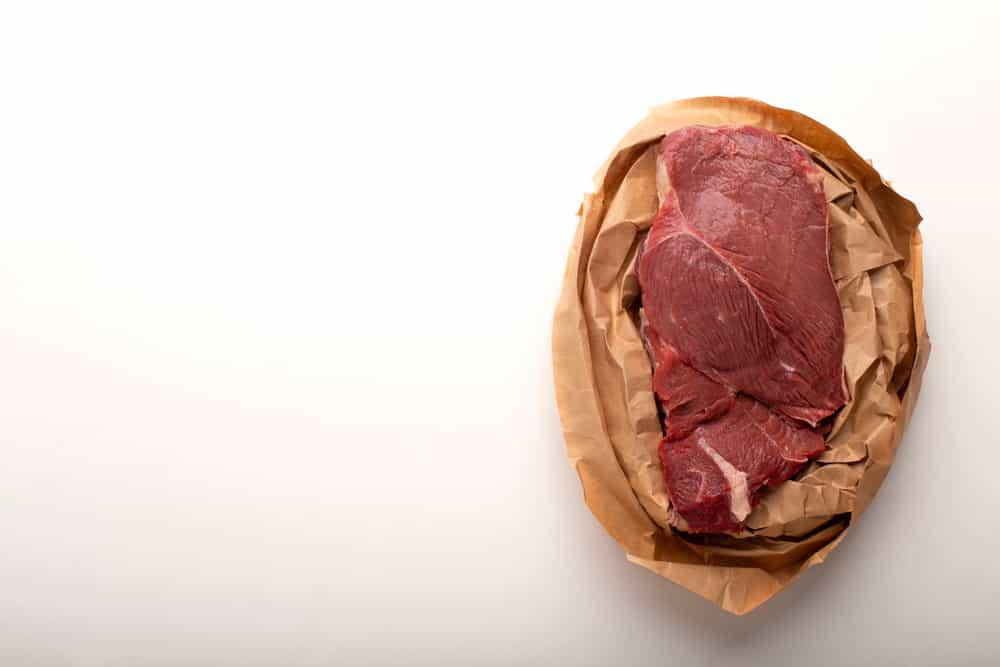 Fresh meat for steak in paper bag