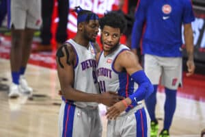 Jerami Grant #9 of the Detroit Pistons and Saddiq Bey #41 of the Detroit Pistons embrace after the Detroit Pistons defeated the Boston Celtics 96-93 at Little Caesars Arena on January 01, 2021 in Detroit, Michigan.