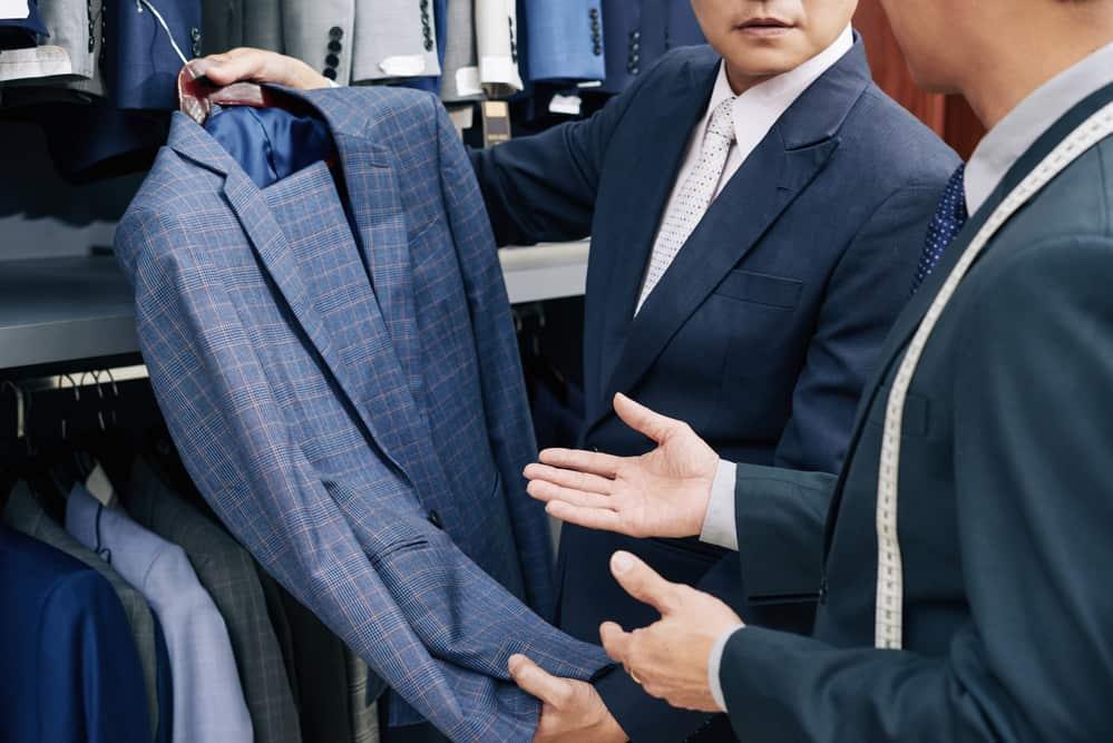 Cropped image of salesman helping customer