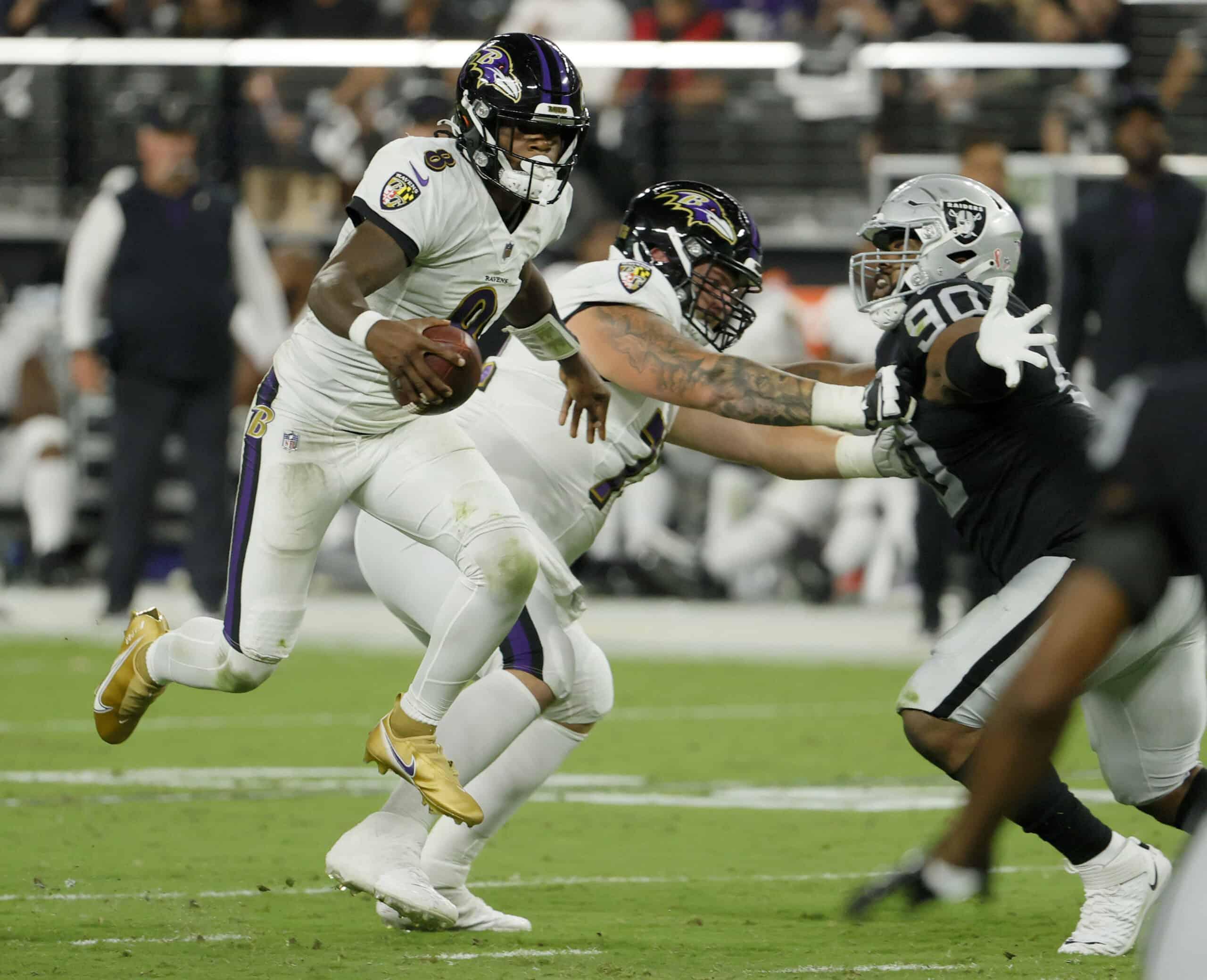 Quarterback Lamar Jackson #8 of the Baltimore Ravens runs against the Las Vegas Raiders during their game at Allegiant Stadium on September 13, 2021 in Las Vegas, Nevada. The Raiders defeated the Ravens 33-27 in overtime.