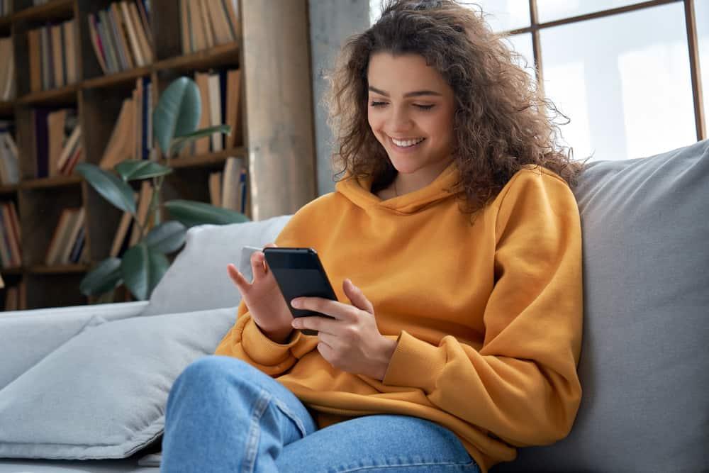teen girl checking social media