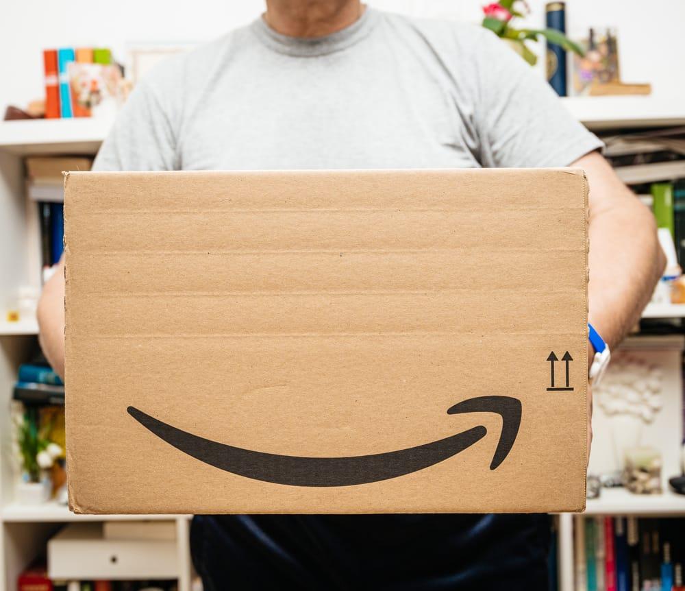 Senior man holding Amazon Prime cardboard parcel